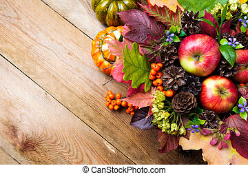 Fall background with blue flowers and colorful leaves, copy space