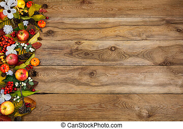 Fall background with pumpkins, apples,  leaves and white flowers
