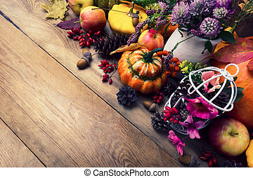 Fall background with pumpkins, clover and pink flowers, copy space