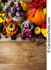 Fall background with pumpkins, pink and clover flowers, copy space