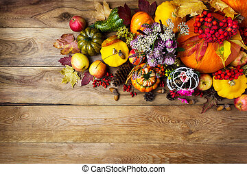 Fall background with pumpkins,and clover flowers, copy space
