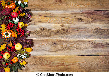 Fall background with rowan and oak leaves, pumpkins, apples, copy space