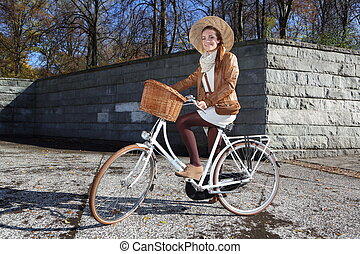 Fall bike ride  - woman on a bike tour in the city park