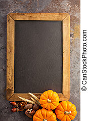 Fall chalkboard copy space with pumpkins