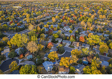 fall colors under wildfire smoke - aerial cityscape of Fort ...