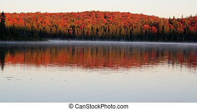 Fall Dawn - The first light of dawn shining on the beautiful...