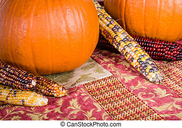 Fall display of orange pumpkins and corn