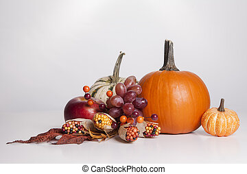 Fall Display - A group of fall decorations sit together on a...