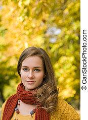 Fall fashion portrait with foliage. - Fall fashion portrait...