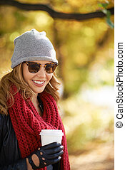 Fall fashion - Portrait of a stylish woman outdoors in...
