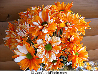 Orange and white button Mums in floral arrangement