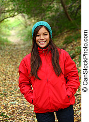 Fall forest woman - Autumn woman happy and smiling looking...