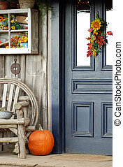 Fall front porch with a pumpkin