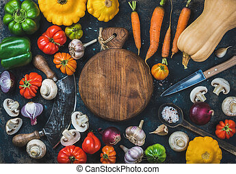 Fall harvest vegetable ingredients and knives for healthy...