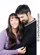 fall in love - happy couple standing together against a...