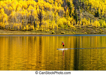 Fall in Steamboat Springs Colorado - Young woman paddle...