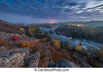 Fall landscape with river on sunrise