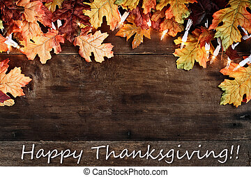 Fall Leaves and Text Happy Thanksgiving over Wooden ...