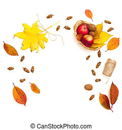 Fall leaves, apple, acorns and twine on white background. Autumnal and thanksgiving concept. Flat lay
