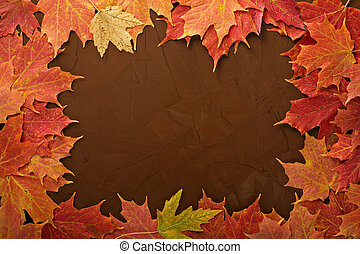 Fall leaves frame on brown background