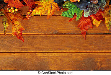 Fall leaves on wooden background