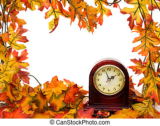 Fall time change - Fall leaves with clock isolated on white,...