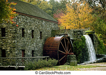 Old mill and water wheel in the New England fall