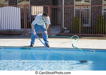 Fall pool service - Service man cleaning pool filters, ...
