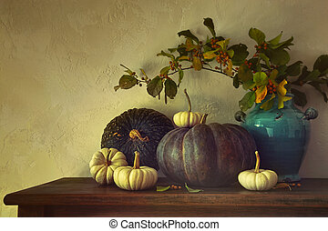 Fall pumpkins and gourds on table with vintage feel