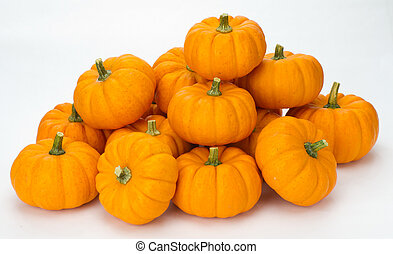 Fall pumpkins stacked for decoration