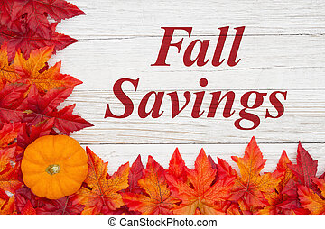Fall Savings message with red and orange fall leaves with a pumpkin on weathered wood