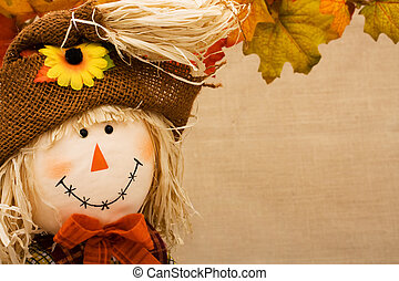 Fall Scene - Fall leaves with a scarecrow making a border on...