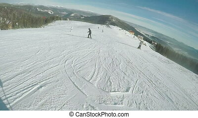 Riding on ski run and fall