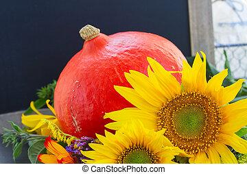 fall sunflowers with pumpkin