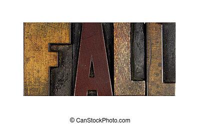 The word FALL written in vintage letterpress type