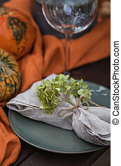 Fall themed holiday table setting arrangement for a seasonal party