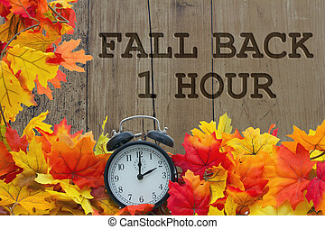 Fall Time Change, Autumn Leaves and Alarm Clock with grunge...