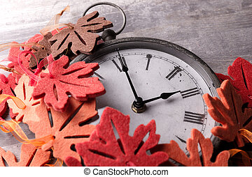 Autumn Leaves and Clock with grunge wood