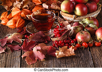 Fall wealth on rustic wooden background with notes