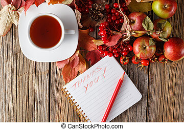 Fall wealth with message thank you on rustic wooden background
