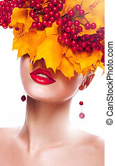 Fall. Woman with Wreath of Maple Leaves and Berries