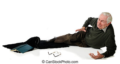 Fallen Senior - A senior man in pain after slipping on an...