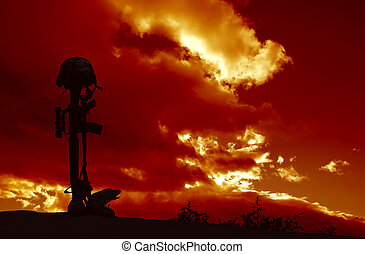 An AR-15 rifle with combat helmet and boots silhouetted against a stormy sky as a memorial to a fallen soldier.
