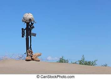 Fallen Soldier Memorial - AR-15 rifle with combat helmet and...