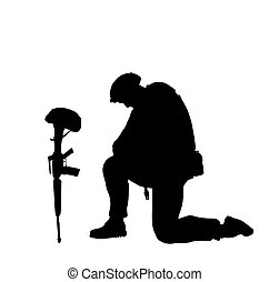 Soldier honoring fallen comrade in arms.