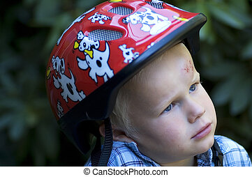 This boy was trying to bike for the first time, and ended up with his head on the streets... If he had only used his helmet!