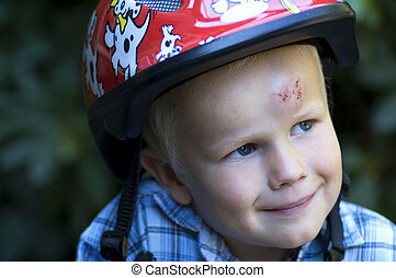 This boy was trying to bike for the first time, and ended up with his head on the streets... If only he had used his helmet!