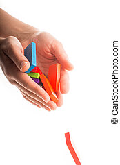 Falling colorful domino in hand