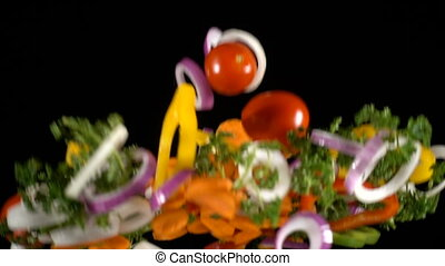 Falling cuts of colorful vegetables, slow motion
