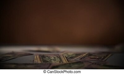 Falling dollars isolated on dark black background Slow Motion 400 fps